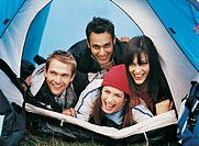 Four Young Adults Lying On Top of Each Other in a Tent