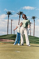 Portrait of a Mother and Daughter Standing on the Putting Green of a Golf Course