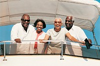Portrait of Happy Senior Couples Standing on Deck of a Boat