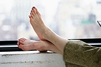 Feet resting on window ledge