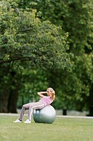 Woman Using a Fitness Ball in a Park