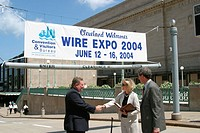 Wire Expo banner behing business people handshaking, Convention Center. Cleveland. Ohio, USA