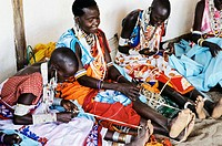 Dressmakers at Masaai village (´manyatta´). Rift Valley, Kenya