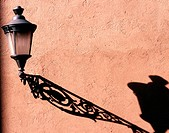Lamp on cement wall with beautiful shadow. Rome. Italy