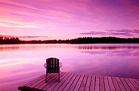 Lifestyles. Early dusk. Adirondack chair at lake. Near Anchorage. Southcentral Alaska. USA