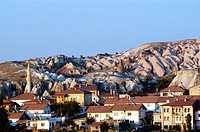 Village with back drop of rock formations. Çavusin, Cappadocia. Turkey.