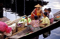 A vegetable seller is cruising with her canoe between the floating houses in the Inle lake and offering her market to the local residences. Inle Lake,...