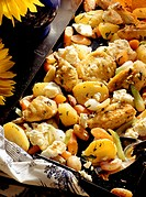 Sage potatoes, chicken, vegetables, sheep cheese on baking tin