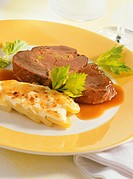 Stuffed leg of venison with potato gratin
