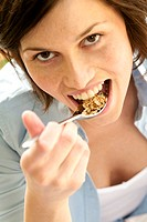 Woman eating oat muesli
