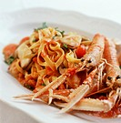 Ribbon pasta with scampi and tomatoes