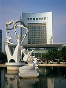 People Square: City Hall and basin with sculptures at fore. Hangzhou. Zhejiang province, China