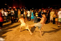 People playing capoeira
