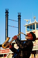 Musician playing in front of steamboat ´Natchez´ on Mississippi river. New Orleans. Louisiana, USA
