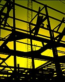 Silhouette of building under construction.