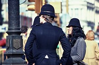 British police officer viewed from the back.