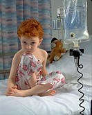 Leukemic boy in hospital bed hooked to EKG.