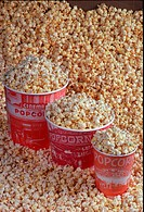Table top pop corn in three containers.