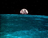 Rising earth as seen from moon. The moon is the only natural satellite of the earth and with the sun is responsible for the tides on earth.
