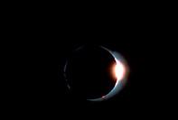 Solar eclipse showing solar flares.