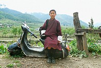 School boy, Haa, Bhutan, sitting on a scooter