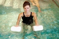 WOMAN IN REHABILITATION<BR>Photo essay.<BR>Therapy pool at Dinan, in the Britanny region of France.   The sensation of weightlessness is the large adv...