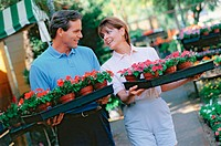 couple buying flowers for the garden