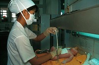 A HOSPITAL IN ASIA<BR>Photo essay from hospital.<BR>Tu Du Obstetrics Hospital, in Saigon, Vietnam. Initial care of newborn.