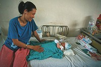 A HOSPITAL IN ASIA<BR>Photo essay from hospital.<BR>Tu Du maternity ward in Saigon, Vietman. Young mother with her baby.