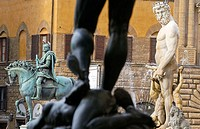 Statue of Cosimo I de Medici by Giambologna and 'Il Biancone', statue of Neptune, in Piazza della Signoria. Florence. Tuscany, Italy