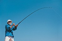 Senior Man Fishing Against a Blue Sky