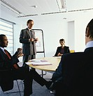Business Manager Leading a Presentation Meeting in a Conference Room
