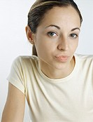 Young woman looking at camera with lips puckered, close-up