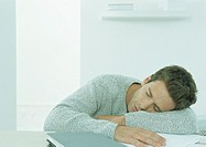 Man sleeping at table