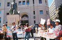 Demonstration for a compensation law in front of Salvador Allende monument in Plaza de la Libertad. Santiago de Chile. Chile