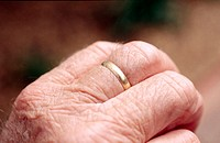 Wedding ring on aged hand