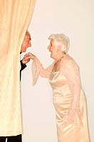 Man kissing a senior womans hand