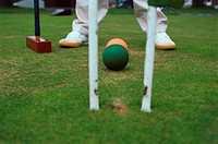 Man playing croquet