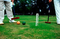 Two men playing croquet