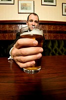 Businessman drinking a pint of lager