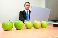 Businessman with apples on desk