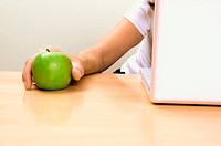 Businessman holding an apple