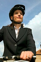 Businesswoman riding a bicycle