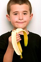 Boy eating a banana