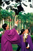 Graduates throwing mortar boards in the air, Malaysia