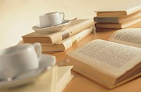 cups of coffee and open book