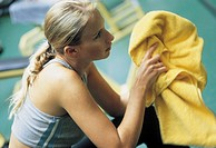 woman with a yellow towel in gym