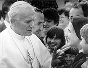 The Pope talks to a nun during his visit to Switzerland in 1985