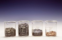 One mole quantities of tin, magnesium, iodine, and copper in separate beakers.