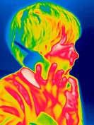 A thermogram of a boy talking on the phone. The temperature range goes from hot (white) to cold (blue). Thermography is a technique for visualizing th...